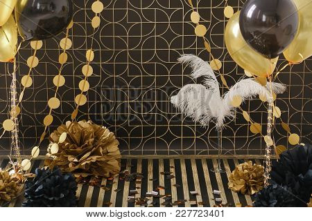 Party Decor. Golden Decoration On Black Background With Ballons And Pom Pom