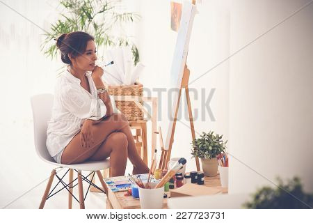 Attractive Woman Thinking What To Paint On The Canvas