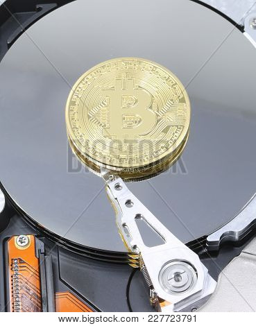 Computer Hard Drive And A Large Golden Bitcoin Coin Symbol Of The New Crypto Currencies