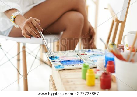 Close-up Image Of Woman Painting With Blue Paint