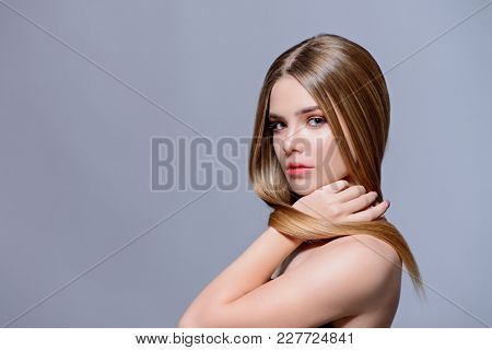 Beauty skin and hair concept. Portrait of a beautiful young woman with healthy shiny skin and hair. Copy space.