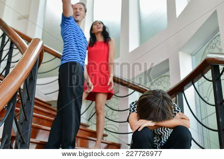 The Concept Of Parental Family Quarrels, Young Couple Parents Are Fighting In Front Of Children.