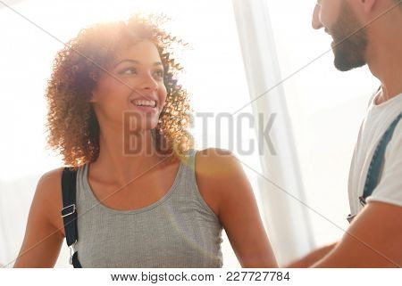 Happy couple standing near the window