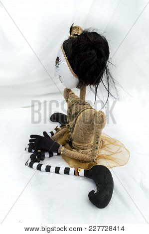 Creepy Steampunk Rag Doll Posed In A Sitting, Kneeling Position Looking Left. Lifesize Doll On A Gru