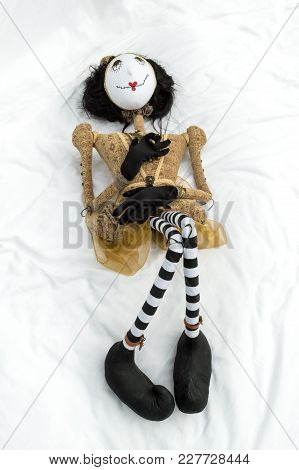 Creepy Steampunk Rag Doll Lying On Back With Raised Knees. Viewed From Above. Lifesize Doll On A Gru