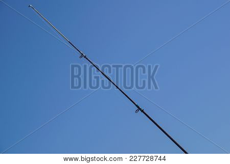 The End Of The Fishing Rod And Blue Sky