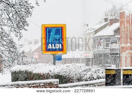 Northampton Uk December 10, 2017: Aldi Logo Sign Under Heavy Winter Snow In Northampton Town Centre.