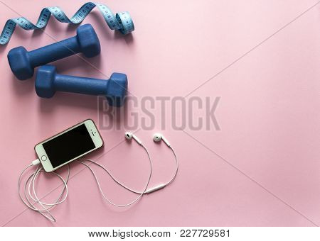 On A Pink Background Dumbbells Blue And Flying Centimeter Figure Sport Headphones Music Phone Iphone