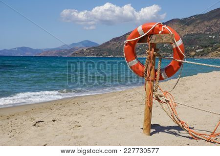 Life Preserver On Sandy Beach Somewhere Near At Sea .