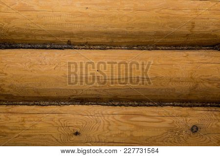 Natural Background Pattern Of A Log Wall. Wall Of A Log House.