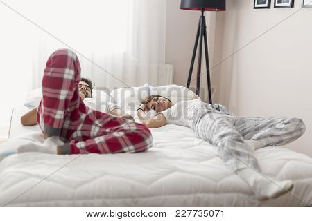 Couple In Love Lying In Bed After Waking Up