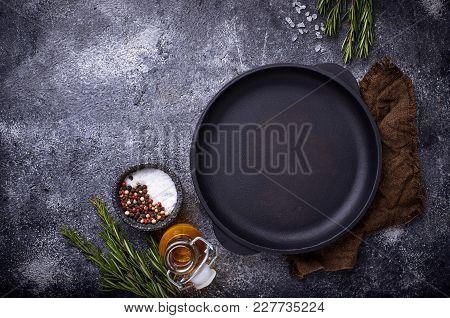 Cast Iron Frying Pan With Herbs And Spices. Top View, Spice For Text