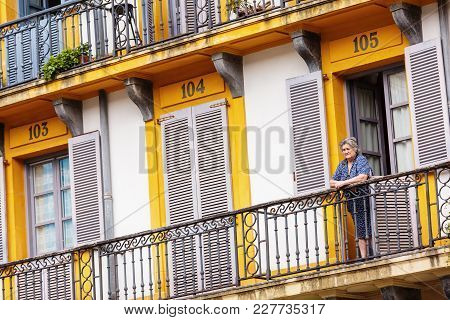 San Sebastian, Spain - September 27, 2016: Old Woman On Balcony In Place Of The Constitution At San