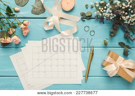 Wedding Background With Calendar. Rings, Present Box, Roses And Lots Of Tender Bridal Stuff On Blue