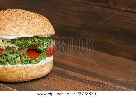Homemade Burger With Fresh Letuce Leaves, Tomatoe Slice, Meat. Homemade Healthy Food Or Fast Food, W