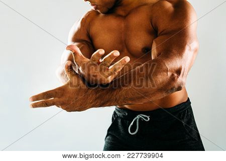 Unrecognizable Male Athlete Show Muscles On His Arms, Cropped Shot