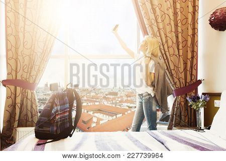 Morning Of A New Day, Woman Standing Near The Window With City View And Taking Selfie. She Is Ready