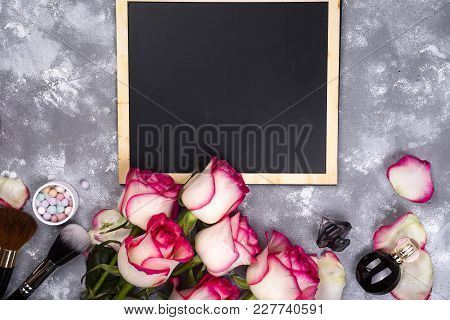 Frame Of Roses And Decorative Cosmetics With A Chalkboard For Copy Space. Styled Womans Day, Mothers
