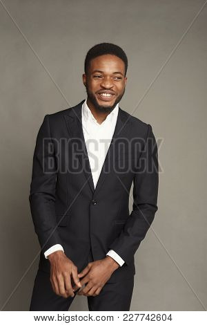 Happy Smiling Young Black Man Portrait In Formal Wear At Grey Studio Background, Crop