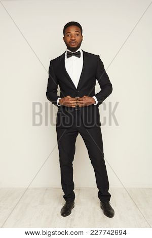 Handsome Young Black Man Portrait In Formal Wear At White Studio Background, Crop