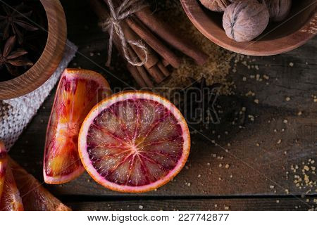 Ingredients For Making Candied Fruits. Fresh Red Orange Fruit, Spices And Walnuts On Rustic Wooden T