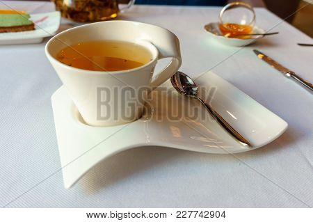Tea Patry. Hot Herbal Tea In A White Cup On White Plate With Spoon