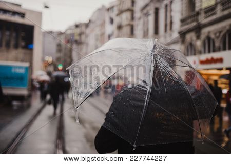 Istanbul, Turkey - February 14, 2018: People Of Istanbul Are Walking In A Rainy Day In Taksim, Istan