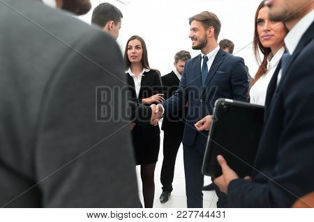 welcome and handshake of business partners in the office.