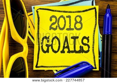 Hand Writing Text Caption Inspiration Showing 2018 Goals. Business Concept For New Yer Resolutions W