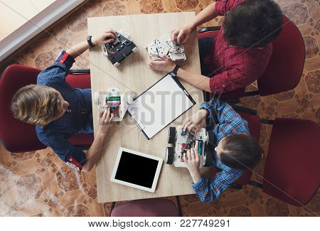 Children Creating Robots At School, Top View, Stem Education, Copy Space. Early Development, Diy, In