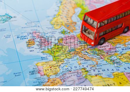 Travelling Abroad By Bus Concept. Red Doubbledecker On The Map, Group Tour To Europe. Tourism And Va