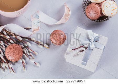 Pink Coffee Mug With Sweet Pastel French Macaroons, Gift Box And Pussy Willow. Flat Lay
