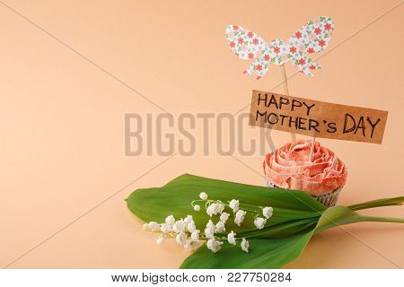 Mothers Day Background, Handmade Greeting Card In Tasty Cupcake And May-lily At Tender Beigebackdrop