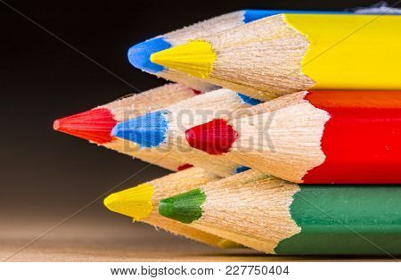 Close Up Of Color Pencils With Different Color Over Blackbackground
