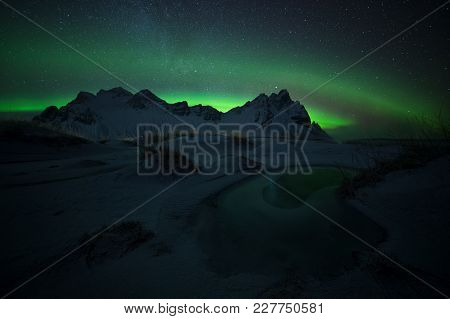 Green Eye, Aurora Borealis At Stokksnes In Iceland