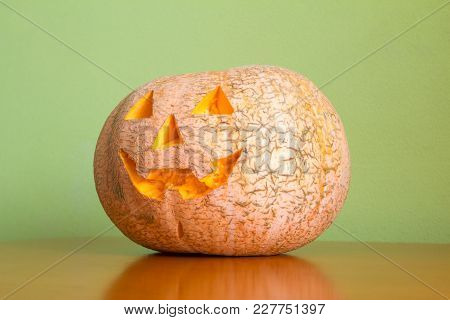Halloween Pumpkin On Table Green Wall, Funny Jack O'lantern