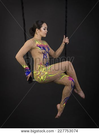 Aerial Acrobat In The Trapeze.