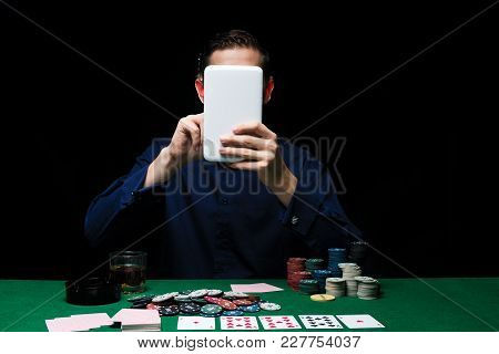 Man Is Playing Poker With Tablet Online. Emotional  Card Player Win In Game, Man Very Happy With Mak