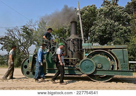 Rollag, Minnesota, Sept 2, 2017: Operators And Crew Of A Buffalo Springfield Steam Engine Participat