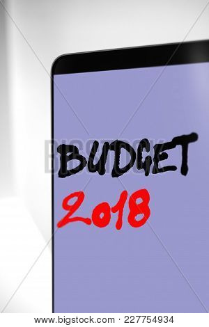 Word, Writing Budget 2018. Business Concept For Budget 2018 Written On Sticky Note Paper On Wooden B