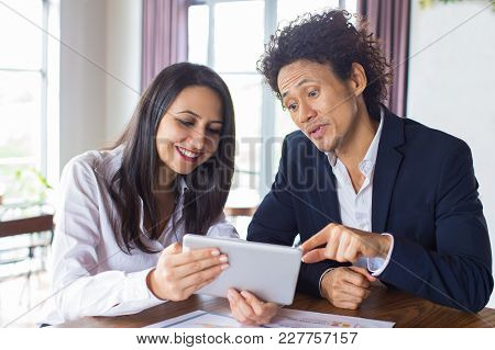Cheerful Multiethnic Business Partners Reading Information Online. Freelancers Searching For New Ide