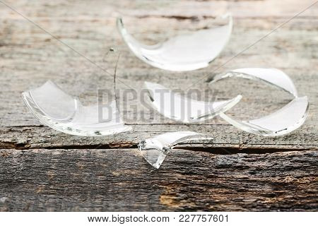 Broken Glass On The Grey Wooden Table