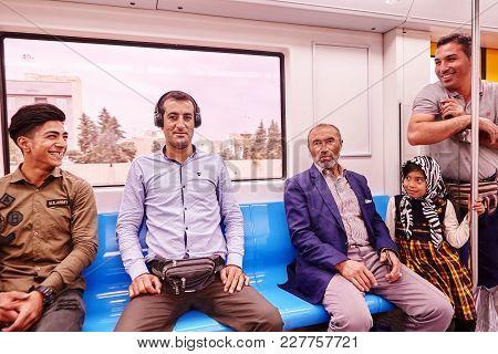 Tehran, Iran - April 29, 2017: Muslim Family Consisting Of Four Men And A Girl Ride In A Subway Trai