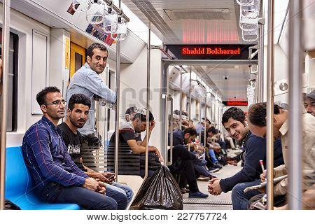 Tehran, Iran - April 29, 2017: Many Iranian Men Are Sitting In A New Modern Subway Train Car.