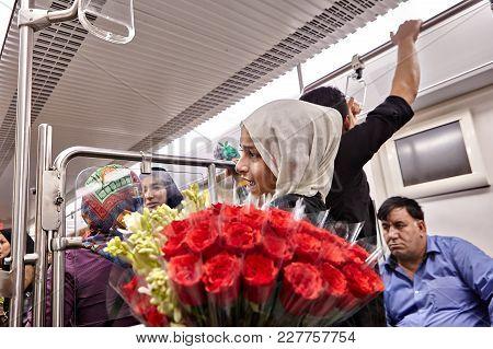 Tehran, Iran - April 29, 2017: One Muslim Girl Dressed In Hijab, Sells Flowers Of Rose Inside The Un