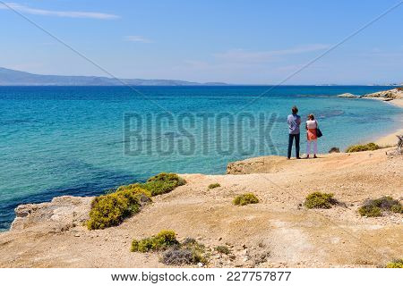 Naxos, Greece - May 24, 2017: Tourists Visit Aliko Beach, One Of The Best Beaches On The South Weste