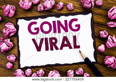Hand Writing Text Caption Inspiration Showing Going Viral. Business Concept For Social Viral Busines