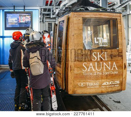 Gondola Lift At Ski Resort In Winter With Skiers And Snowboarders - La Thuile, Valle D'aosta, Italy