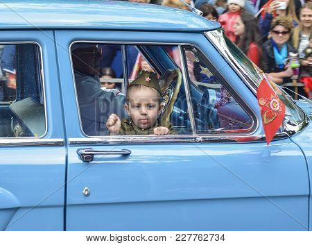 Pyatigorsk, Russia - May 09, 2017: A Little Boy In Uniform For The Day Of Victory In A Gaz-21 Volga.