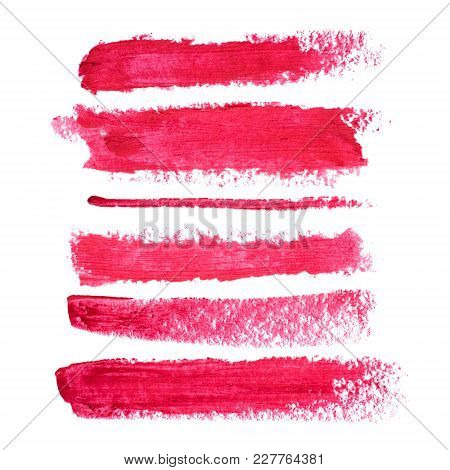 Set Of Red Lipstick Smudges Isolated On White Background. Smudged Makeup Product Sample.